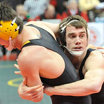 Elyria Catholic's Jerot Schill, right, works against Teagan McFadden of Bainbridge Paint Valley in a Div. III, 160-pound match. DAVID RICHARD / CHRONICLE