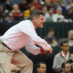 Elyria head coach Erik Burnett mimicks a move to Elyria wrestler Amando Torres during the Division I 113 pound champioship match on Saturday in Columbus.