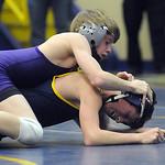 Avon's Joseph Ciresi defeats North Ridgeville's Jake Bober the in 106-weight class. STEVE MANHEIM/CHRONICLE
