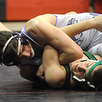 Keystone's Logan Stiner, top, defeats Columbia in the 132 weight class. STEVE MANHEIM/CHRONICLE