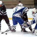 EC's #4 Paul Case tries to work the puck past Trinity's #5 Evan Gilmore & goalie #34 Nate Campbell.