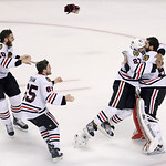 Chicago Blackhawks defenseman Johnny Oduya (27), of Sweden, hugs Chicago Blackhawks goalie Corey Crawford (50) after winning Game 6 of the NHL hockey Stanley Cup Finals 3-2 against the Bosto …