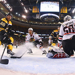 Boston Bruins center David Krejci (46), of the Czech Republic, and Chicago Blackhawks defenseman Duncan Keith (2) rush the net in front of Blackhawks goalie Corey Crawford (50) during the fi …