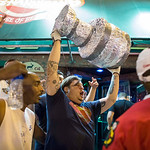 Fans celebrate on West Division Street with a homemade version of the Stanley Cup Trophy in Chicago after the Chicago Blackhawks won the NHL hockey Stanley Cup Finals on Monday, June 24, 201 …