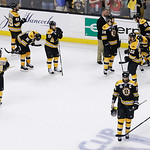 The Boston Bruins stand on ice after being defeated by the Chicago Blackhawks 3-2 in Game 6 of the NHL hockey Stanley Cup Finals, Monday, June 24, 2013, in Boston. (AP Photo/Charles Krupa)