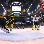 Chicago Blackhawks center Jonathan Toews, left, skates past the net after his puck landed in the net, right, behind Boston Bruins goalie Tuukka Rask, of Finland, as Blackhawks right wing Pat …