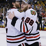 Chicago Blackhawks center Jamal Mayers (22) and right wing Patrick Kane (88) the Stanley Cup after the Blackhawks beat the Boston Bruins 3-2 in Game 6 of the NHL hockey Stanley Cup Finals Mo …