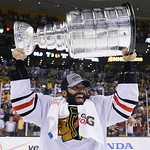 Chicago Blackhawks defenseman Johnny Oduya, of Sweden,hoists the Stanley Cup after the Blackhawks beat the Boston Bruins 3-2 in Game 6 of the NHL hockey Stanley Cup Finals Monday, June 24, 2 …