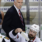 Chicago Blackhawks head coach Joel Quenneville walks behind the bench during the second period in Game 6 of the NHL hockey Stanley Cup Finals against the Boston Bruins, Monday, June 24, 2013 …