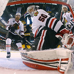 Chicago Blackhawks defenseman Duncan Keith, left, goalie Corey Crawford (50) and defenseman Niklas Hjalmarsson (4), of Sweden, look back to fin the puck, not seen, after Boston Bruins left w …