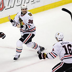 Chicago Blackhawks center Dave Bolland (36) celebrates his game-winning goal against the Boston Bruins with Chicago Blackhawks center Marcus Kruger (16) during the third period in Game 6 of  …