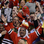 Chicago Blackhawks fans celebrate after the Blackhawks beat the Boston Bruins 3-2 in Game 6 of the NHL hockey Stanley Cup Finals Monday, June 24, 2013, in Boston. (AP Photo/Elise Amendola)