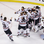 The Chicago Blackhawks celebrate their 3-2 win over the Boston Bruins in Game 6 of the NHL hockey Stanley Cup Finals, Monday, June 24, 2013, in Boston. (AP Photo/Charles Krupa)