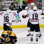 Chicago Blackhawks left wing Bryan Bickell, center, celebrates his goal with Chicago Blackhawks center Jonathan Toews (19) and Chicago Blackhawks center Michal Handzus (26), of Slovakia, dur …