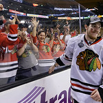 Chicago Blackhawks center Andrew Shaw skates from the glass after celebrating with fans after the Blackhawks beat the Boston Bruins 3-2 in Game 6 of the NHL hockey Stanley Cup Finals Monday, …