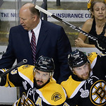 Boston Bruins center Chris Kelly (23) and left wing Daniel Paille, right, hop from the bench in front of head coach Claude Julien during the second period in Game 6 of the NHL hockey Stanley …