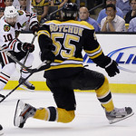 Chicago Blackhawks center Patrick Sharp (10) shoots as Boston Bruins defenseman Johnny Boychuk (55) defends during the third period in Game 6 of the NHL hockey Stanley Cup Finals Monday, Jun …