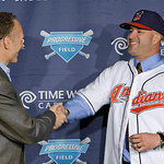 Cleveland Indians vice president and general manager Mark Shapiro, left, shakes hands with manager Manny Acta at a news-conference Monday, Oct. 26, 2009, in Cleveland. Acta, fired as the Was …