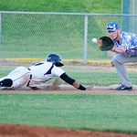 Ironmen's Carlos Ortiz slides safely back to first as Champion City Kings' first baseman Corey Pool catches the throw. KRISTIN BAUER   CHRONICLE