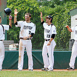 The Lorain County Ironmen bench high five Scott Splett after scoring one of three runs in the bottom of the fifth against Slippery Rock yesterday at The Pipe Yard in Lorain. (CT photo by Ann …