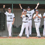 The Lorain County Ironmen dugout celebrates as three runners score in the bottom of the fifth inning on Slippery Rock errors yesterday afternoon at The Pipe Yard in Lorain. The Ironmen beat  …