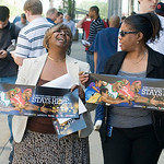 Basketball fans Tynetia Winters, left, and Arlene Underwood, right, both of Cleveland, use their lunch break on Thursday, July 1, 2010, in Cleveland, to show their support for LeBron James s …