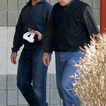 Cleveland Browns place kicker Phil Dawson, left, leaves the NFL team's headquarters with Tom Petersburg of Athletes in Action Monday, Jan. 3, 2011, in Berea, Ohio. Earlier the Browns fired h …