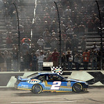 Kurt Busch celebrates after winning the NASCAR Sprint Cup Series auto race at Texas Motor Speedway on Sunday, Nov. 8, 2009, in Fort Worth, Texas. (AP Photo/Ralph Lauer)