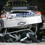 Crew members repair Jimmie Johnson's car after Johnson wrecked in the opening laps of the NASCAR Sprint Cup Series auto race at Texas Motor Speedway on Sunday, Nov. 8, 2009, in Fort Worth, T …