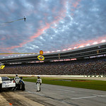 John Andretti makes a pit stop at sunset during the NASCAR Sprint Cup Series auto race at Texas Motor Speedway on Sunday, Nov. 8, 2009, in Fort Worth, Texas. (AP Photo/Ralph Lauer)