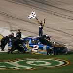 Kurt Busch celebrates his win at the NASCAR Sprint Cup Series auto race at Texas Motor Speedway on Sunday, Nov. 8, 2009, in Fort Worth, Texas. (AP Photo/Mike Fuentes)