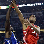 West All-Star Tim Duncan of the San Antonio Spurs goes up for a basket against East All-Star Kevin Garnett of the Boston Celtics during the first quarter of NBA All-Star basketball game Sund …