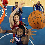 East All-Star Chris Bosh (4) of the Toronto Raptors shoots against West All-Star Pau Gasol of the Los Angeles Lakers during the second half of the NBA All-Star basketball game Sunday, Feb. 1 …