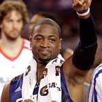 East All-Star Dwyane Wade of the Miami Heat points to he crowd after being named MVP of the NBA All-Star basketball game Sunday, Feb. 14, 2010, at Cowboys Stadium in Arlington, Texas. Wade a …