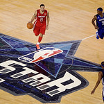 West All-Star Deron Williams of the Utah Jazz (8) brings the ball across center court against East All-Star Rajon Rondo of the Boston Celtics (9) and Paul Pierce of the Celtics in the first  …