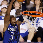 East All-Star Dwyane Wade of the Miami Heat soars for a dunk in the fourth quarter of the NBA All-Star basketball game Sunday, Feb. 14, 2010, at Cowboys Stadium in Arlington, Texas. (AP Phot …