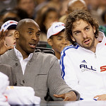 West All-Star Kobe Bryant, left, of the Los Angeles Lakers, watches with Lakers teammate Pau Gasol during the first quarter of the NBA All-Star basketball game Sunday, Feb. 14, 2010, at Cowb …