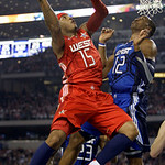 West All-Star Carmelo Anthony (15) of the Denver Nuggets goes up for a basket against against East All-Star Dwight Howard (12) of the Orlando Magic during the NBA All-Star basketball game Su …