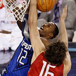 East All-Star Dwight Howard of the Orlando Magic (12) has his shot blocked by West All-Star Pau Gasol of the Los Angeles Lakers (16) in the first quarter of the NBA All-Star basketball game  …