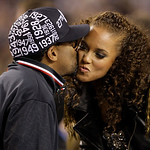 Filmmaker Spike Lee, left, kisses Alicia Keys during halftime of the NBA All-Star basketball game Sunday, Feb. 14, 2010, at Cowboys Stadium in Arlington, Texas. (AP Photo/LM Otero)