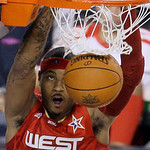West All-Star Carmelo Anthony of the Denver Nuggets dunks during the third quarter of the  NBA All-Star basketball game Sunday, Feb. 14, 2010, at Cowboys Stadium in Arlington, Texas. (AP Pho …