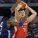 West All-Star Dirk Nowitzki of the Dallas MAvericks shoots against East All-Star Chris Bosh of the Toronto Raptors during the second quarter of the NBA All-Star basketball game Sunday, Feb.  …