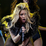 Shakira performs at halftime of the NBA All-Star basketball game Sunday, Feb. 14, 2010, at Cowboys Stadium in Arlington, Texas. (AP Photo/Eric Gay)