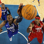 East All-Star Dwight Howard of the Orlando Magic (12) blocks a shot by West All-Star Carmelo Anthony of the Denver Nuggets (15) in the firs half of the NBA All-Star basketball game Sunday, F …