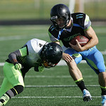 Nightmares quarterback Cody Schuster takes a hit from a Celtics linebacker on a keeper play. RAY RIEDEL/CHRONICLE