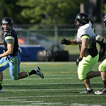 Nightmares' quarterback Cody Schuster scrambles to pass against the Celtics. RAY RIEDEL/CHRONICLE
