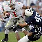Ohio State running back Dan Herron (1) rushes against Penn State's Eric Latimore (56) and Sean Lee (45) during the first half of an NCAA college football game in State College, Pa., Saturday …