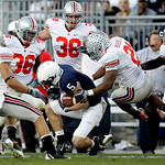Penn State wide receiver Graham Zug (5) is surrounded by Ohio State players Kurt Coleman (4), Brian Rolle (36) , Austin Spitler (38) and Devon Torrence (10) as defensive back Russell Anderso …