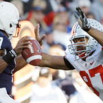 In this Saturday, Nov. 7, 2009, photo, Penn State quarterback Daryll Clark (17) looks to pass as Ohio State defensive tackle Cameron Heyward (97) moves in during the first half of an NCAA co …