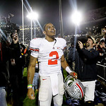 Ohio State quarterback Terrelle Pryor (2) celebrates their win over Penn State with fans after an NCAA college football game in State College, Pa., Saturday, Nov. 7, 2009. Ohio State won 24- …
